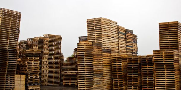 stacked wooden pallets - used